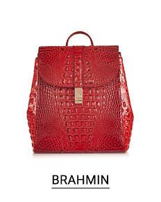 A red croco leather handbag. Shop Brahmin.