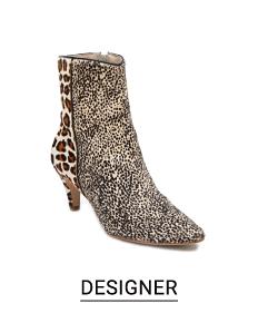 A patchwork animal print boot. Shop designer.