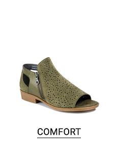 A gray suede open toed comfort shoe. Shop comfort.