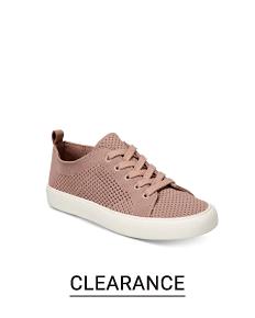 A beige sneaker. Shop clearance.