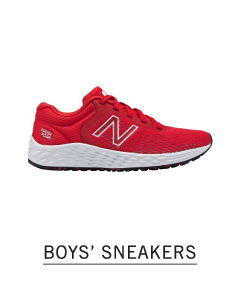 A red sneaker with a white side New Balance logo. Shop boys sneakers.