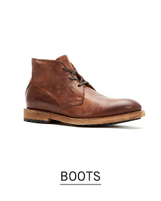 A brown leather work boot style boot. Shop boots.