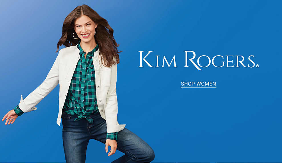 A woman in a green and navy plaid shirt, white denim jacket and jeans. Kim Rogers. Shop women.
