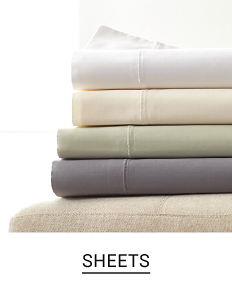 A stack of folded sheets in a variety of colors. Shop sheets.