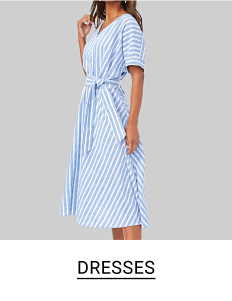 Woman in a light blue and white striped tie waist dress with short sleeves and v-neck. Shop dresses.
