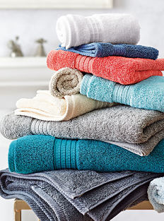 2 stacks of folded towels, washcloths & hand towels in a variety of colors. Shop bath towels.