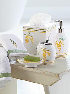 An assortment of white, yellow & green bath accessories. Shop bath accessories.