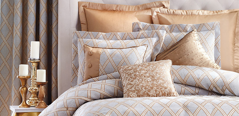 A bed made with a bronze & gray patterned comforter & matching pillows. Dream of Fall Colors. Our favorite fall bedding styles. Shop now.