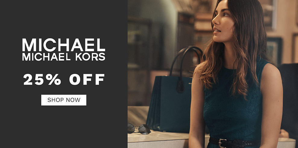 A woman wearing a dark green sleeveless top sitting next to a dark green leather tote. 25% off Michael Michael Kors. Shop now.