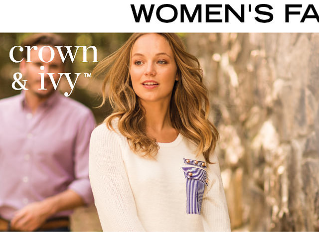 A woman wearing blue jeans & a white sweater with a blue & white striped pocket with gold stud detail. Women's Fall Fashion. Crown & Ivy. Shop Crown & Ivy.