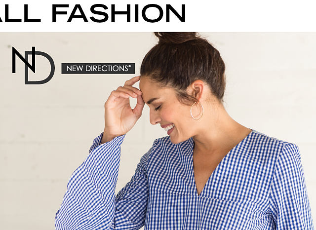 A woman wearing a blue & white checked top & blue jeans. Women's fall fashion. New Directions. Shop New Directions.