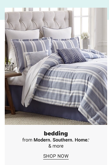 A bed with a blue and white stripe comforter and pillows to match. Bedding from Modern Southern Home and more. Shop now.