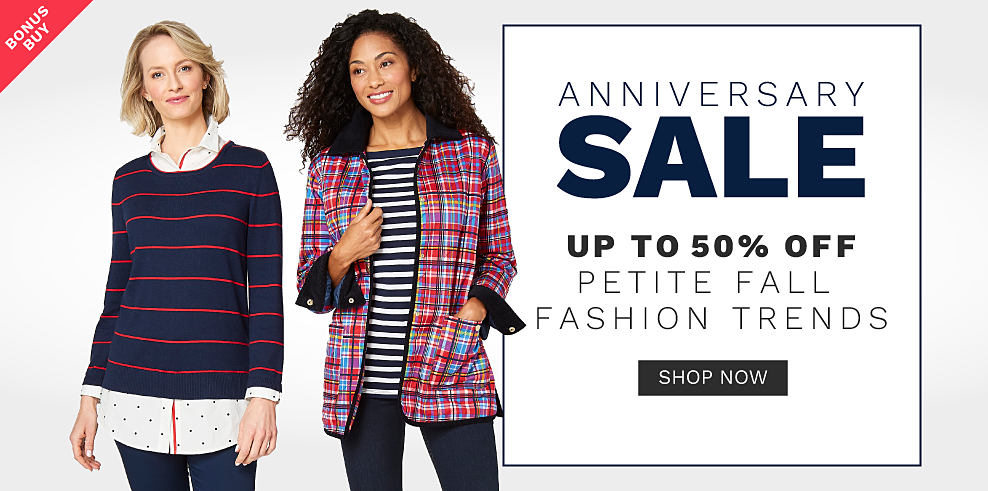 A woman wearing a navy sweater with red horizontal stripes over a white blouse & blue jeans standing next to a woman wearing a red, blue & white plaid open front sweater over a black & white horizontal striped top & blue jeans. Anniversary Sale. Bonus Buy. Up to 50% off petite fall fashion trends. Shop now.