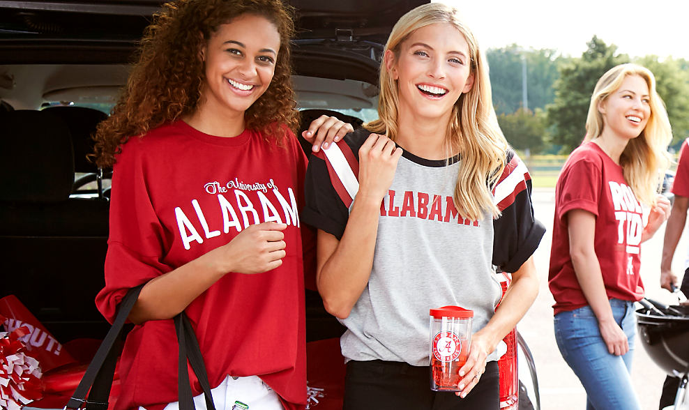3 young women wearing different styles of Alabama team shirts.