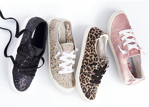 An assortment of fashion sneakers. Shoes. Shop now.