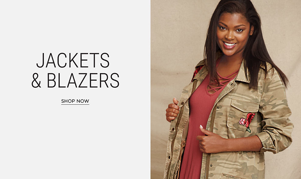A woman wearing a camo jacket over a maroon dress. Jacket & blazers. Shop now.