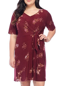 A young woman wearing a burgunday floral print short sleeved dress. Shop dresses.
