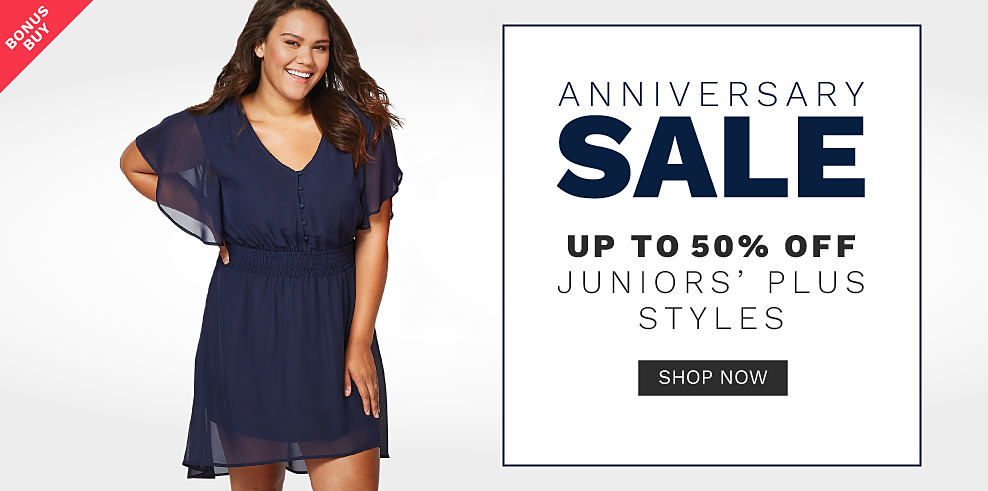 A young woman wearing a navy short sleeved dress. Anniversary Sale. Bonus Buy. Up to 50% off juniors plus fall fashion trends. Shop now.