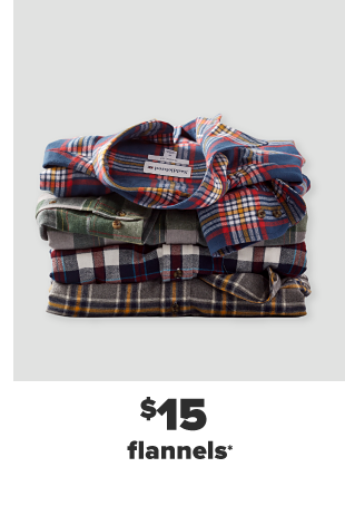Four folded flannels in a stack in various colors. $15 men's and women's flannels.