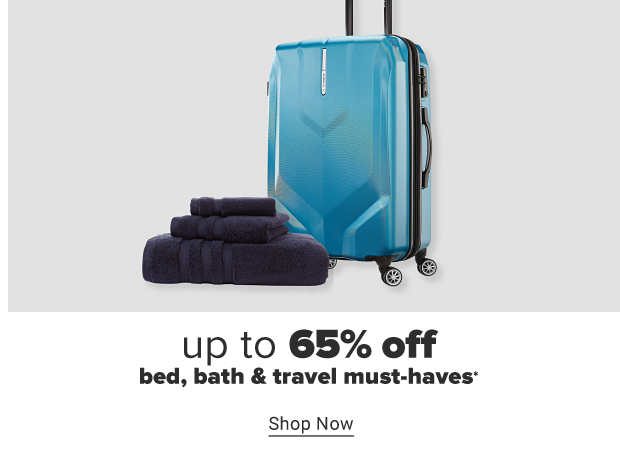 Three black towels of various sizes in a folded stack. A blue spinner suitcase. Up to 65% off bed, bath and travel must haves. Shop now.