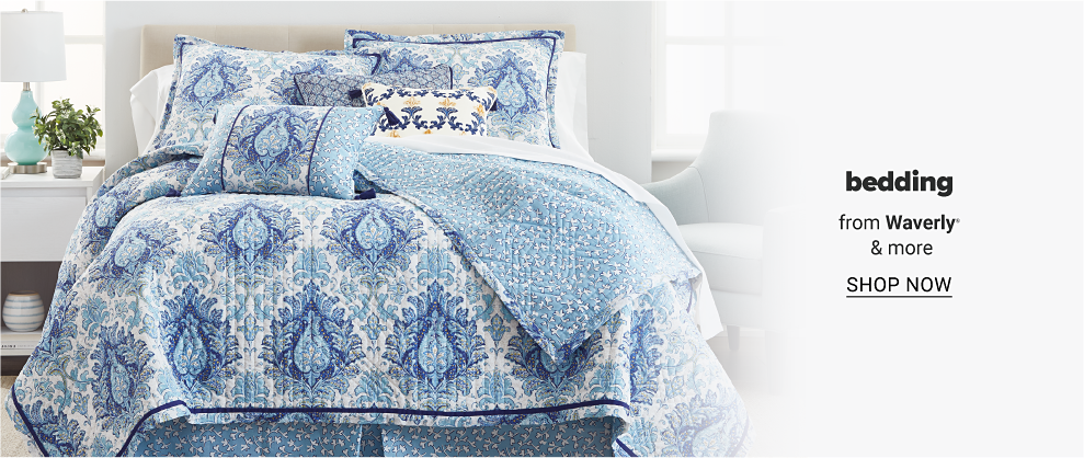 A white and blue print quilt with a reversible print with pillows to match. Bedding from Waverly and more. Shop now.