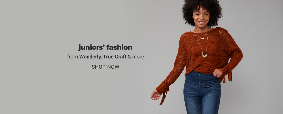 Girl in a dark orange woven sweater with tie accents on the wrists, two layered gold necklaces and jeans. Juniors' fashion from Wonderly, True Craft and more. Shop now.