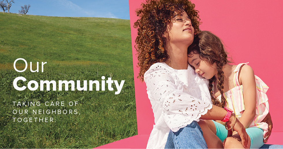 Woman in white eyelet bell sleeve shirt and jeans holding a young girl in her lap who is wearing a bright pink and yellow striped tank top and teal shorts. Our community. Taking care of our neighbors, together.