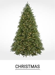 An artificial christmas tree with lights. Shop Christmas