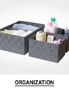 Gray baskets filled with bathroom essentials. Shop organization.