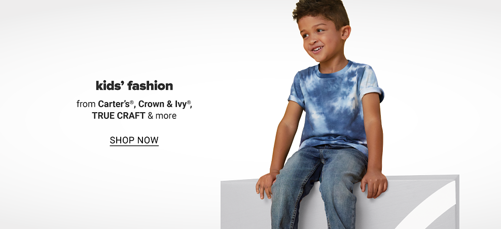 Young boy in a blue and white tie dye shirt and jeans. Kids' fashion from Carter's, Crown and Ivy, True Craft and more. Shop now.