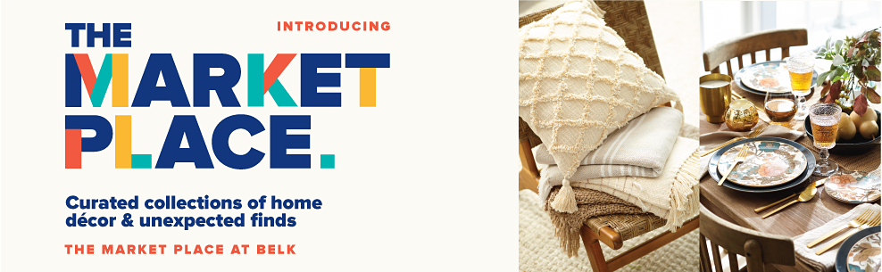 A white pillow with tassel accents on top of a stack of neutral toned blankets on a chair. A table setting with a variety of plates, utensils, glasses and decor. Introducing The Market Place. Curated collections of home decor and unexpected finds. The Market Place at Belk