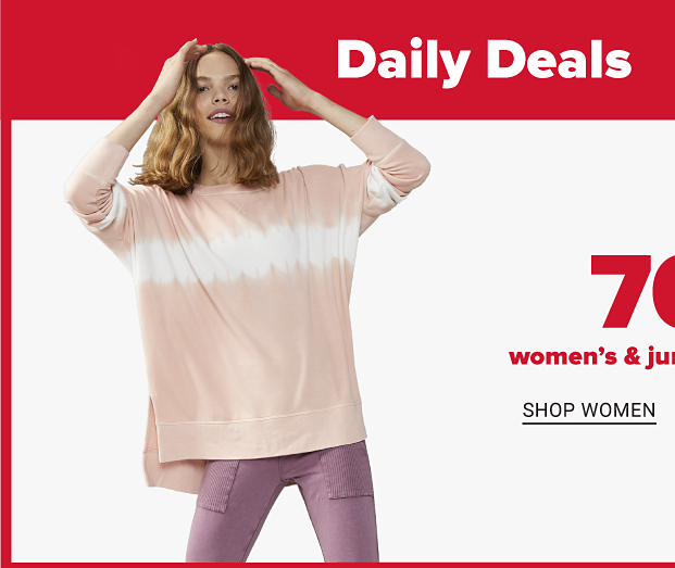 A woman in a faded pink long sleeve shirt with a white, tie dye like horizontal stripe across the front and purple pants. A woman in a blue, pink and white tie dye shirt, unbuttoned to reveal a white shirt underneath. Seventy percent off women's and juniors' fashion. Shop women. Shop juniors.