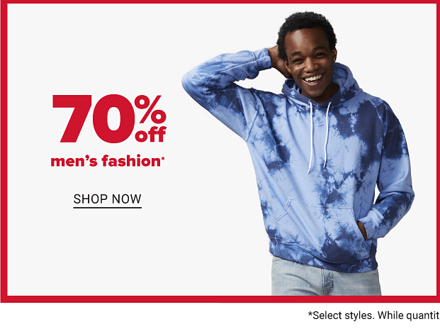 A man in a blue tie dye hoodied and gray jeans. Seventy percent off men's fashion. Shop now.