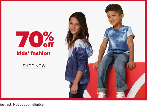 A girl in a blue and white tie dye hoodie and a boy in a blue and white tie dye shirt. Seventy percent off kids' fashion. Shop now.