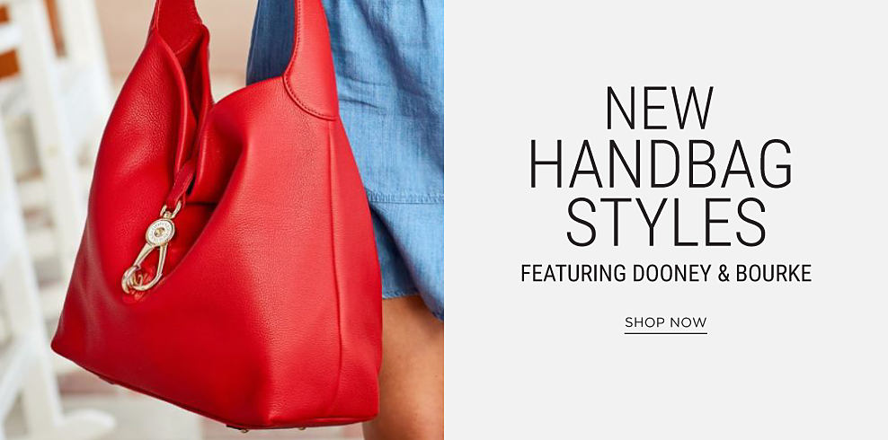 A woman carrying a red leather Dooney & Bourke handbag. New handbags styles featuring Dooney & Bourke. Shop now.