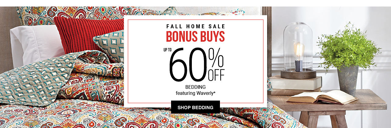 A bed made with a multi-colored patterned comforter & a variety of different colored pillows. Fall Home Sale Bonus Buys. Up to 60% off bedding featuring Waverly. Shop bedding.