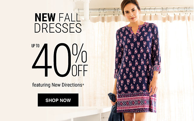 A woman wearing a multi-colored print dress. New & noteworthy dresses. Shop dresses.