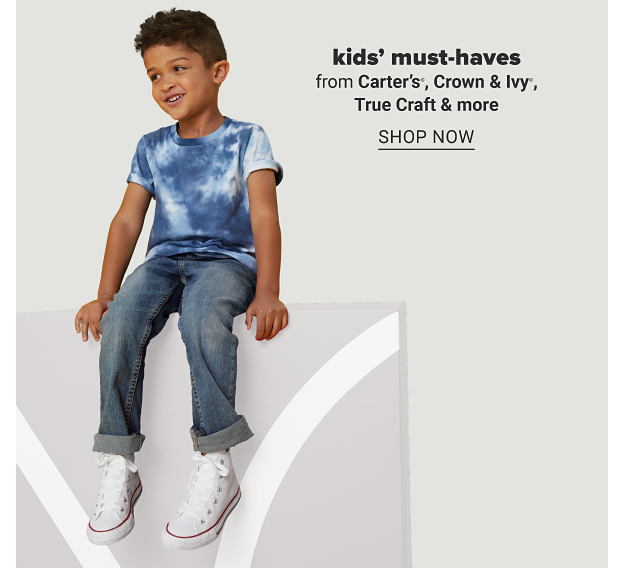 A boy in a blue and white tie dye, jeans and white sneakers. Kids' must haves from Carter's, Crown and Ivy, True Craft and more. Shop now.