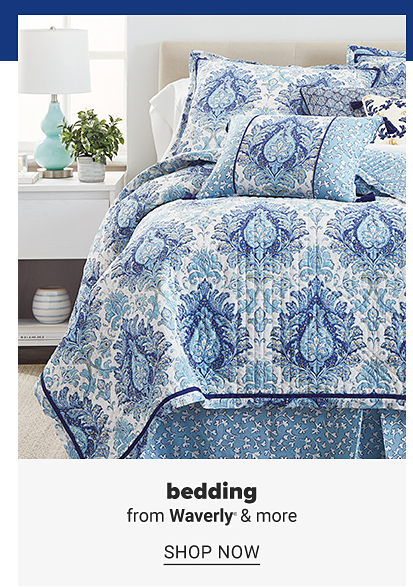 A bed with a blue and white printed quilted and pillows to match. Bedding from Waverly and more. Shop now.