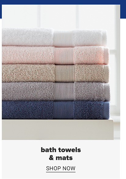 A stack of folded towels in a variety of colors. Bath towels and mats. Shop now.