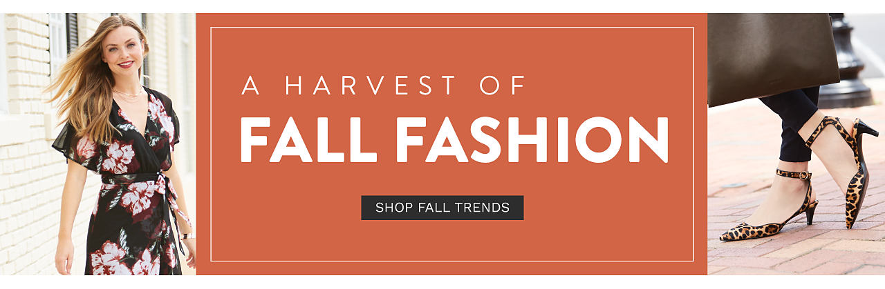 A model wearing a floral wrap dress with short sleeves. A harvest of fall fashion. Shop fall trends.