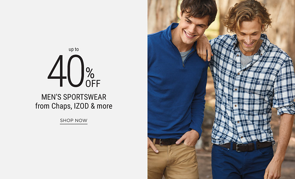 A young man wearing a blue pullover fleece, gray T-shirt & khaki pants standing next to a young man wearing a blue & white plaid button-front shirt, gray T-shirt & blue jeans. Up to 40% off men's sportswear from Chaps, IZOD & more. Shop now
