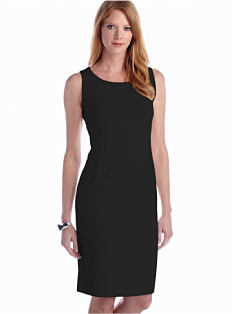 A woman wearing a little black dress. Shop dresses.