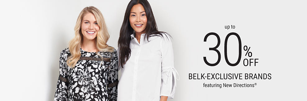 One woman wearing a black and white printed top and dark pants and another woman wearing a white button-down shirt and printed navy pants. Up to 30% off Belk-exclusive brands featuring New Directions