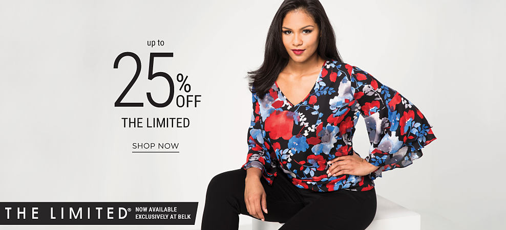A woman wearing a multi-colored floral print top. Up to 25% off THE LIMITED. Now available excluisvely at Belk. Shop now