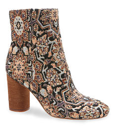 A multi-colored print suede boot. Shop boots.