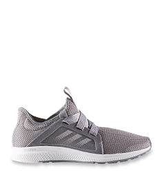 A gray athletic shoe. Shop sneakers.