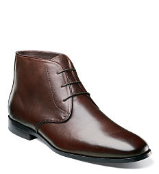 A brown leather men's shoe. Shop men's shoes.