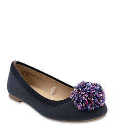 A black girls' flat with multi-colored pom-pom detail. Shop kids shoes.