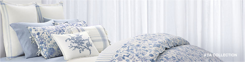 A bedding set in a blue and white floral pattern with matching pillows. Ada Collection. Lauren Ralph Lauren.
